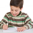 Adorable child writing in the school — Stock Photo #9431838