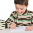 Stock Photo: Adorable child writing in the school