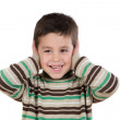 Adorable child stoppering his ears - Stockfoto