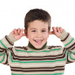 Stock Photo: Adorable child stoppering his ears