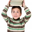 Adorable child with many books on the head — Stock Photo #9431898