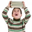 Adorable child with many books on the head — Stock Photo