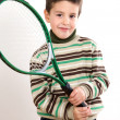 Adorable boy with racket of tennis - Stock Photo