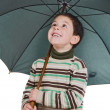 Adorable boy with open umbrellas — Stock Photo