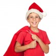 Adorable child with Santa Hat looking in sack — Stock Photo