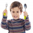 Child with a spoon and fork — Stock Photo #9431954