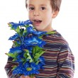 Adorable boy with flowers — Stock Photo #9431956