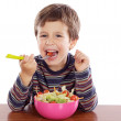 Child eating salad — Stock Photo #9431967