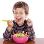 Child eating salad — Stock Photo