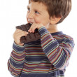 图库照片: Child eating chocolate