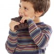 Foto de Stock  : Child eating chocolate