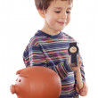 Adorable little boy with hammer for breaking the money box — Stock Photo