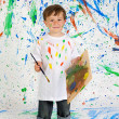 Boy playing with painting — Stock Photo