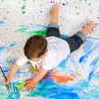 Boy playing with painting — Stock Photo #9432006
