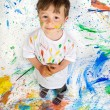 Boy playing with painting — Stock Photo #9432034