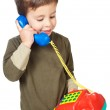 Adorable boy speaking on the telephone — Stock Photo #9432045