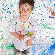 Boy playing with painting — Stock Photo #9432053