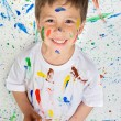 Boy playing with painting — Stock Photo #9432055