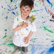 Boy playing with painting — Stock Photo #9432056