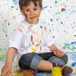 Little boy playing with painting — Stock Photo #9432060