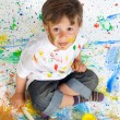 Boy playing with painting — Stock Photo #9432061