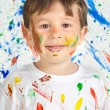 Boy playing with painting — Stock Photo #9432064