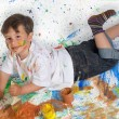 Boy playing with painting — Stock fotografie