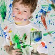 Boy playing with painting — Stock Photo #9432068