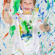 Boy playing with painting — Stock Photo #9432070