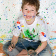 Boy playing with painting — Stock Photo #9432071