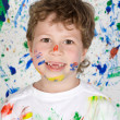 Boy playing with painting — Photo