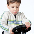 Boy driving a toy car — Stock Photo