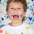 Boy playing with painting — Stock Photo #9432096