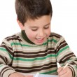 Adorable child writing in the school — Stock Photo #9432099