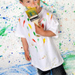 Boy playing with painting — Stock Photo #9432105