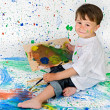 Boy playing with painting — Stock Photo #9432111