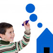 Adorable boy drawing a blue house — Stock Photo #9432112