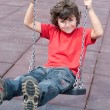 Happy child on the swing — Stock Photo