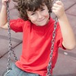 Stock Photo: Happy child on the swing