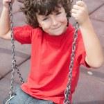 Happy child on the swing — Stock Photo
