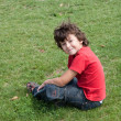 Stock Photo: Happy child sitting on the grass