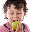 Child biting an apple — Stock Photo #9432269