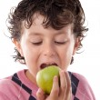 Child biting an apple — Stock Photo