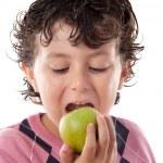 Child biting an apple — Stock Photo