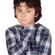 Sad child with plaid t-shirt — Stock Photo