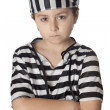 Stock Photo: Sad child with prisoner costume