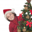 Beautiful child with Christmas trees — Stockfoto