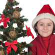 Beautiful child with Christmas trees — Stock Photo