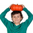 Beautiful little boy with a big pumpkin — Stock Photo