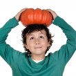 Beautiful little boy with a big pumpkin — Stock Photo #9432378